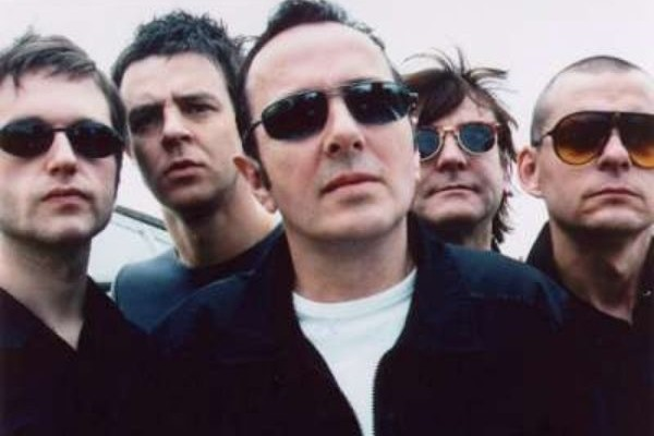Joe Strummer and The Mescaleros photographed by Epitaph Records